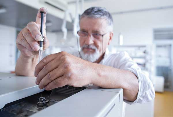 Syringe injection of sample into Gas Chromatograph