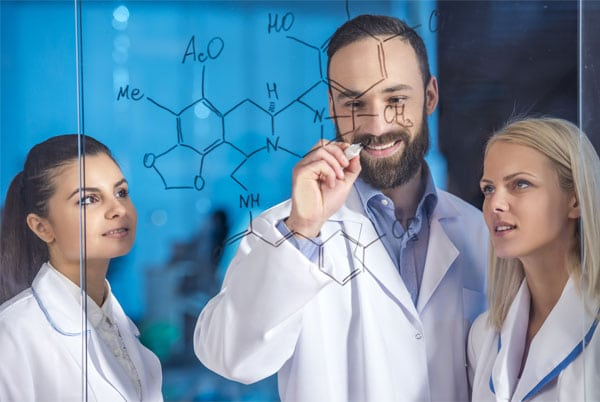 Laboratory scientists with team leader