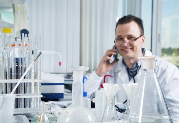 Scientist talking on phone in laboratory