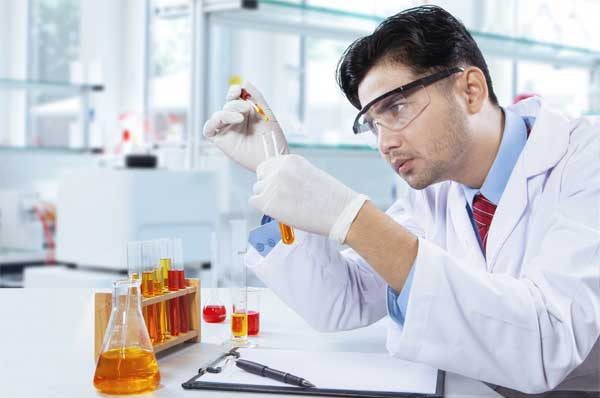 Young analytical chemist in action