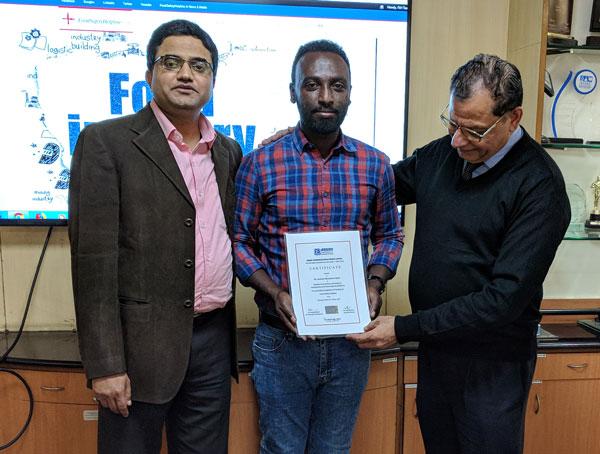 Mr. Gashaw receiving certificate