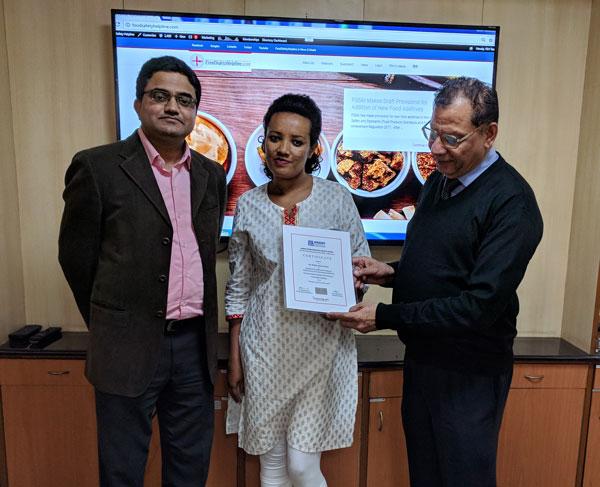 Ms. Bekelu receiving certificate