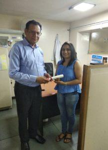 Dr Deepak Bhanot awarding certificate of distinguished service
