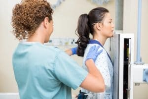 Preparing patient for chest X-ray examination